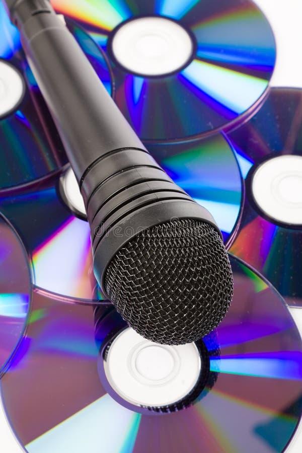 Micrófono y Cd negros imagen de archivo