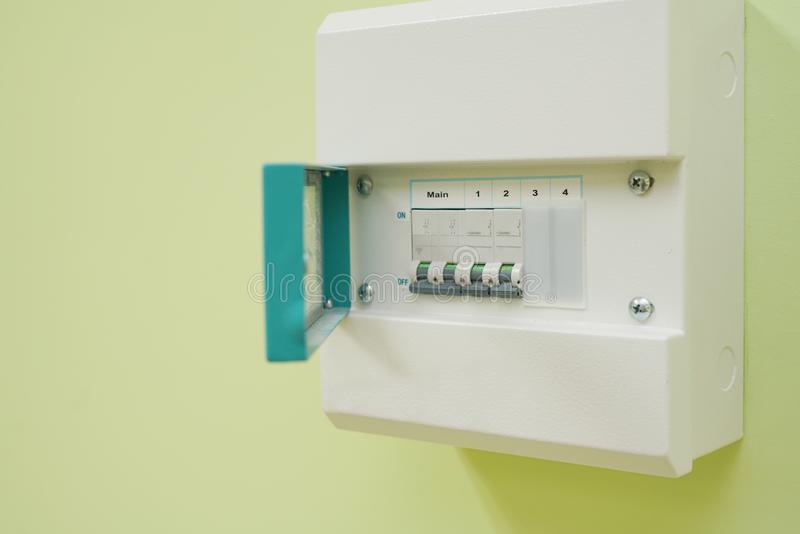 Micro Circuit Breaker or electrical breaker and consumer unit or fuse box on green wall stock image