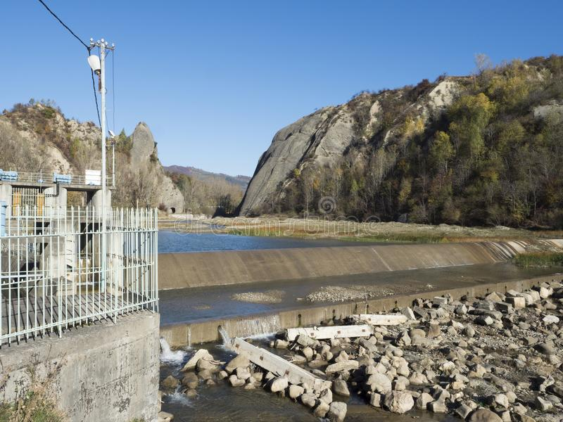 Micro hydroelectric power plant on Doftana river valley stock photography