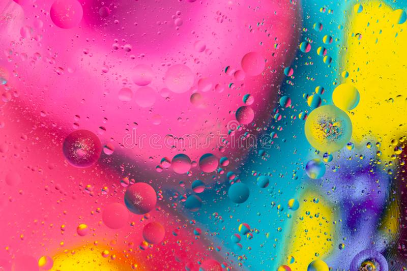 Micro molecular abstract pattern of colored oil bubbles on water. stock image