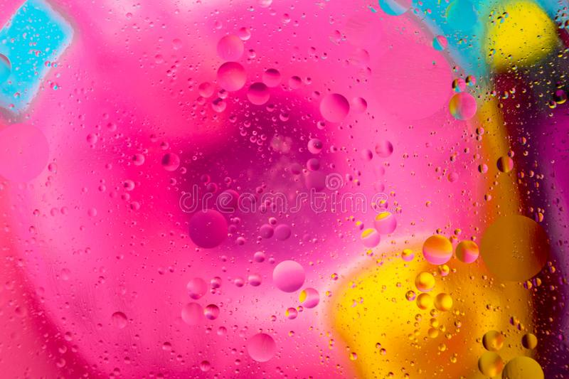 Micro molecular abstract pattern of colored oil bubbles on water. royalty free stock photography