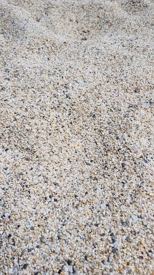 Micro pietre sulla spiaggia immagini stock libere da diritti