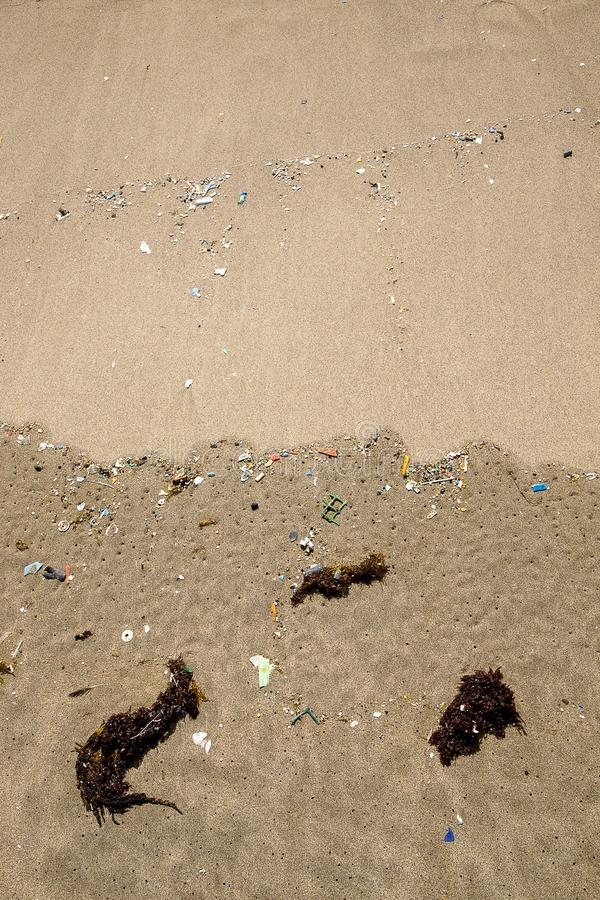 Micro plastics polution on the beach. Plastic polution on the shoreline in orzola, lanzarote, part of the canary islands stock photo