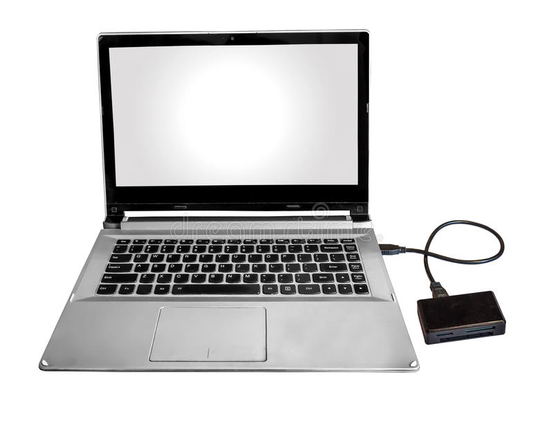 Micro SD and flash card reader connected with Laptop pc via data chord isolated in white. royalty free stock images