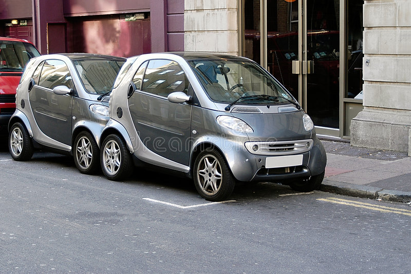 Micro smart cars share space stock photography