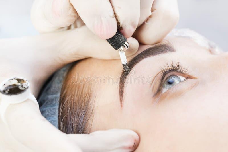 Microblading eyebrows workflow stock photo