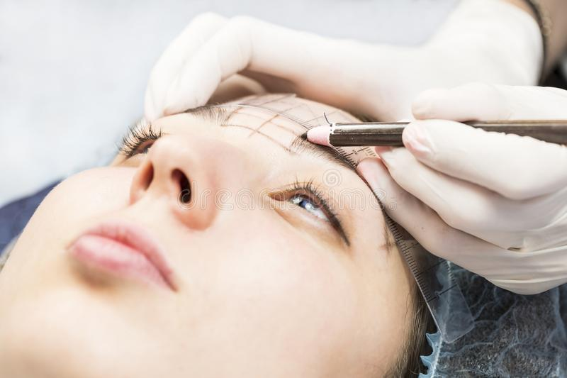 Microblading eyebrows workflow stock photography