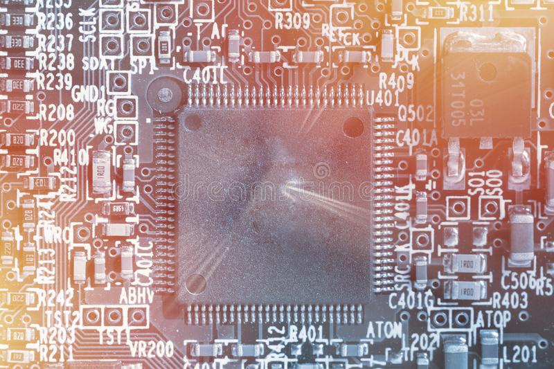 Microchip background - close-up of electronic circuit board royalty free stock image