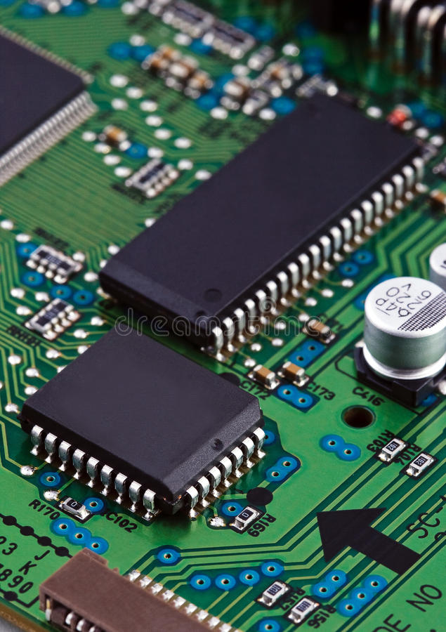 Microchips on circut board royalty free stock photography