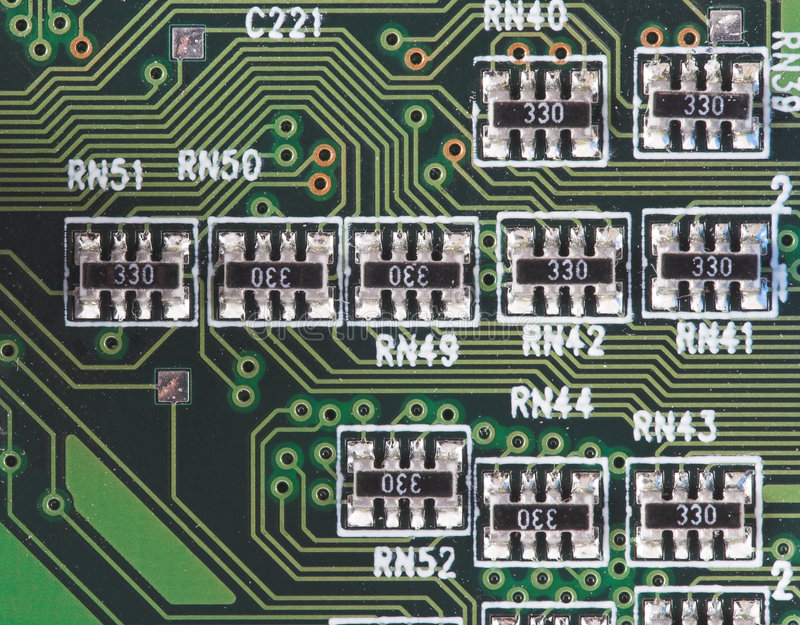 Microcircuit. Close-up of microcircuit with some conductors and resistors stock photo