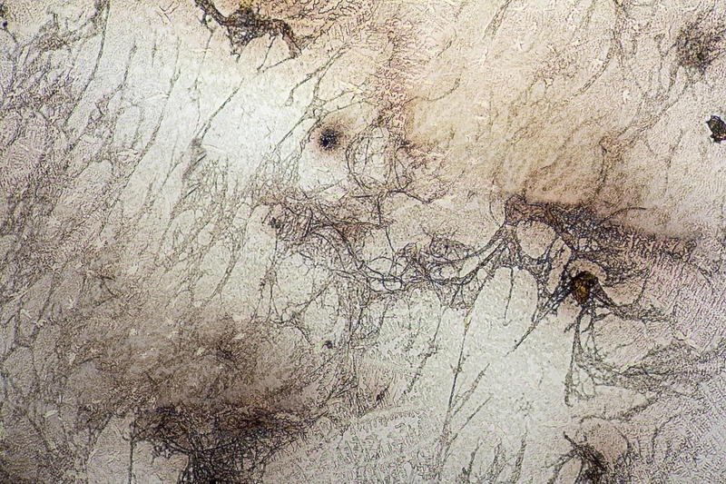Microcrystal structures in dried dyestuff. Microscopic shot showing some microcrystal patterns in dried dyestuff stock photos