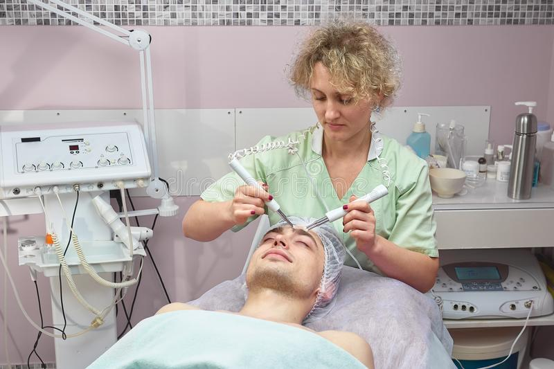 Microcurrent face skin treatment. stock images