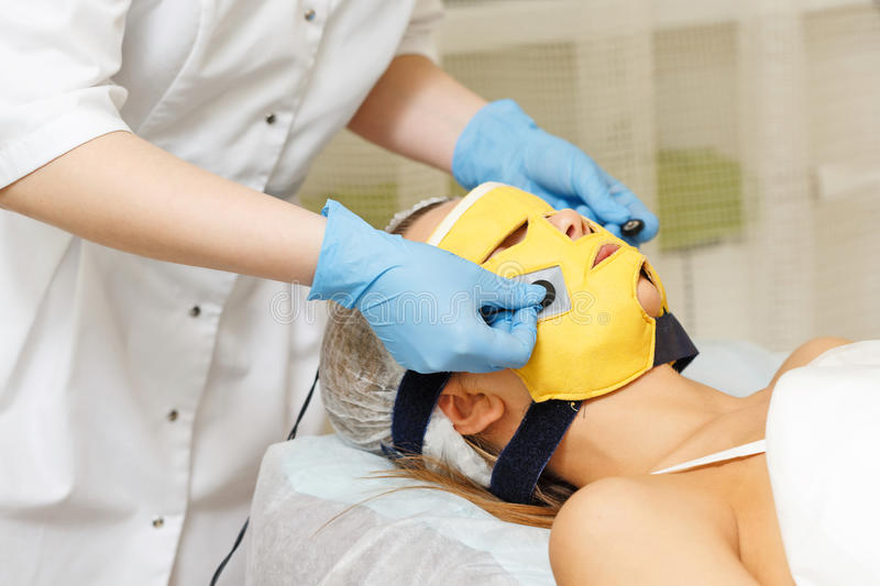Microcurrent therapy. Hardware cosmetology. royalty free stock photography