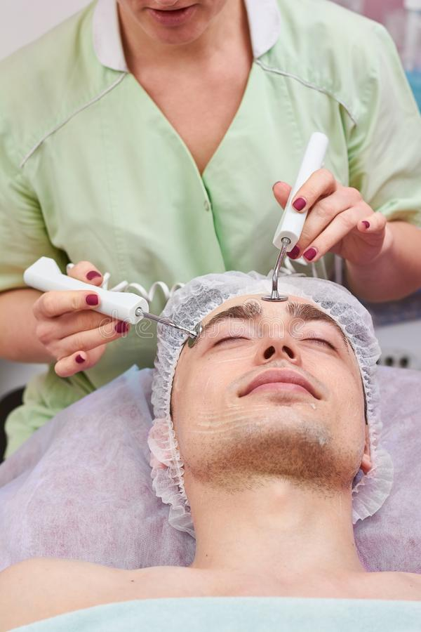 Microcurrent therapy, young man. stock photo