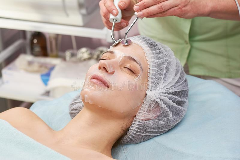 Microcurrent therapy, young woman. royalty free stock photos