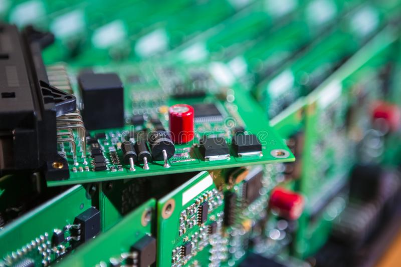 Microelectronics Industry and Manufacturing. Stack of Produced Printed Circuit Boards with Surface Mounted Components. One PCb royalty free stock photos