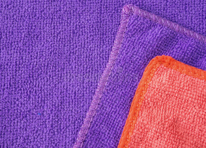 Microfiber cloth surface. Violet and red microfiber cleaning cloth surface texture background stock images