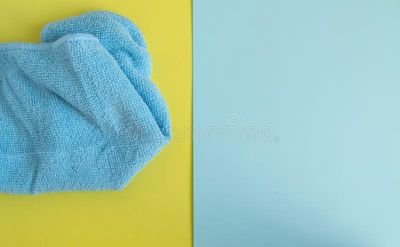 Microfiber cloth on yellow background, top view. Spring cleaning and household concept. Advertising space with copy space, flat royalty free stock images