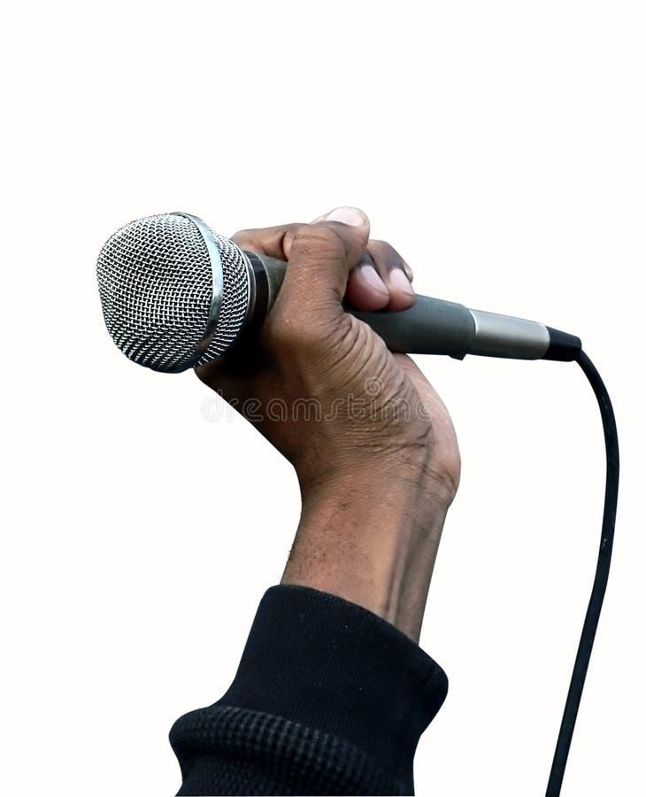 Microfone da terra arrendada da mão fotografia de stock royalty free