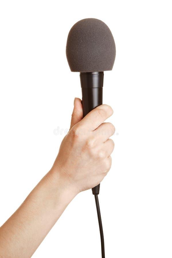 Microfone da terra arrendada da mão acima imagens de stock royalty free