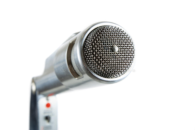 Microfone de prata do vintage no branco. fotografia de stock royalty free