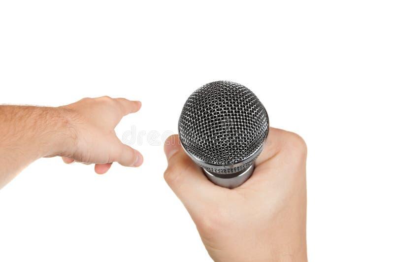 Microfone em uma mão fotos de stock