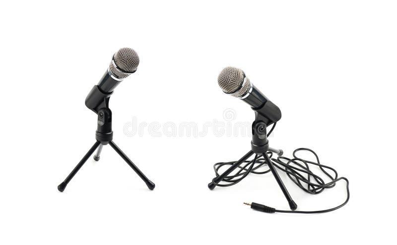 Microfone preto em uma cremalheira isolada imagens de stock