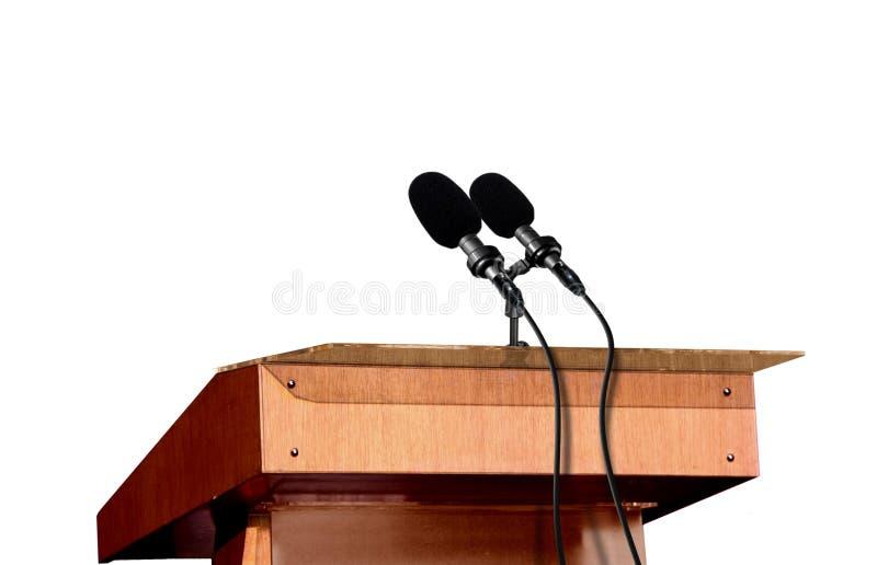 Microfoni sul podio immagini stock libere da diritti