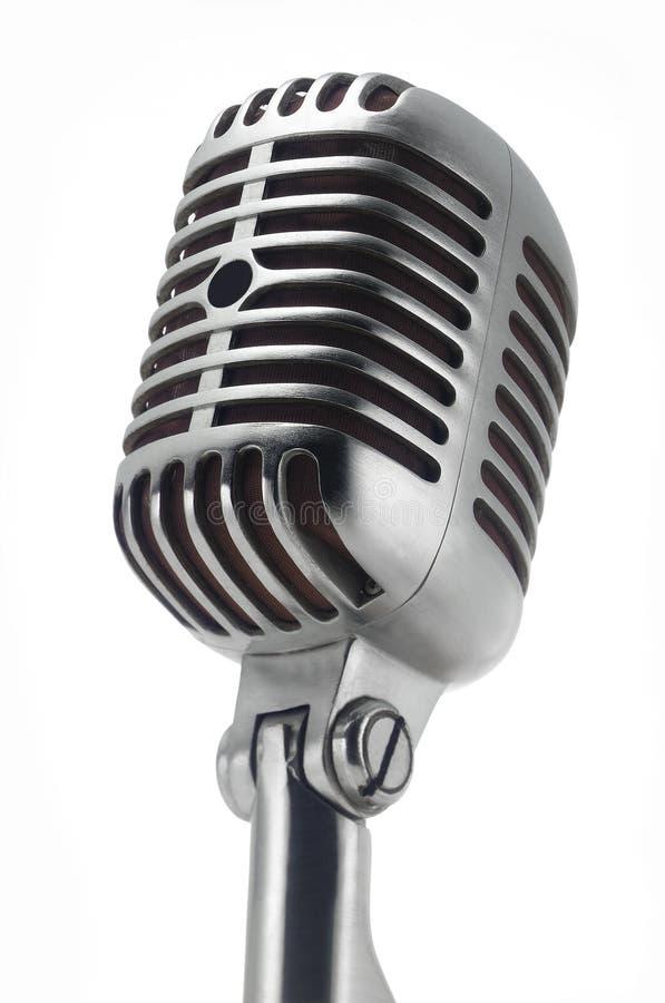 Microfono dell'annata su bianco immagini stock