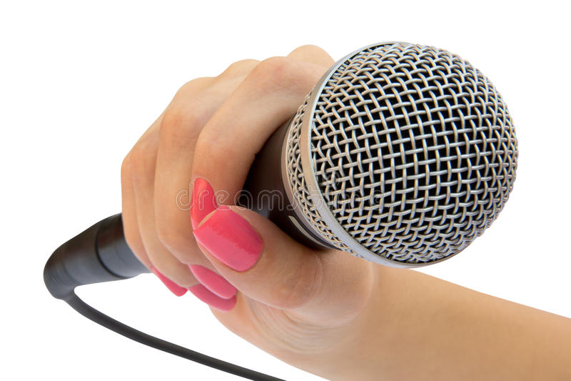 Microfoon in een hand royalty-vrije stock afbeeldingen