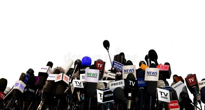 Microfoons tijdens persconferentie stock afbeeldingen