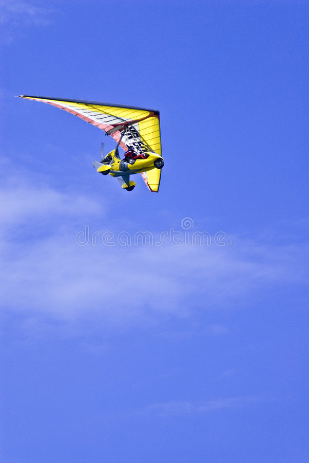 Microlight in blue sky royalty free stock image
