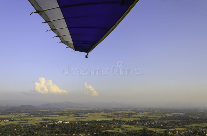 Microlight flight. View of the surrounding countryside during a microlight flight with part of the wing structure visible royalty free stock photos