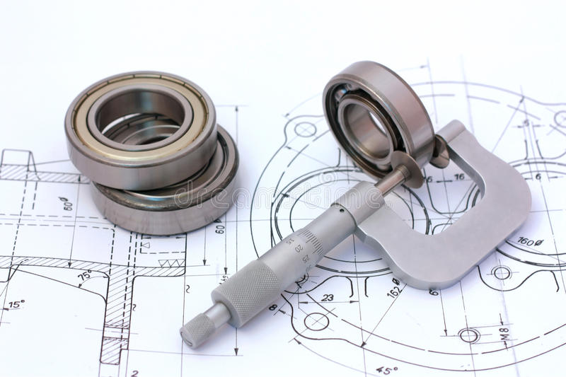 Micrometer measuring ball bearing. On technical drawing stock photos