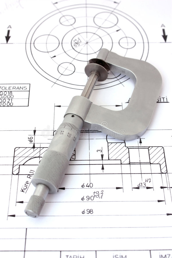 Micrometer on technical drawing. Vertical royalty free stock photo
