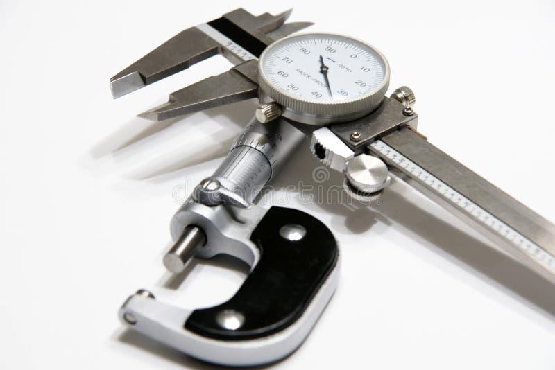Micrometro e compasso fotografia stock