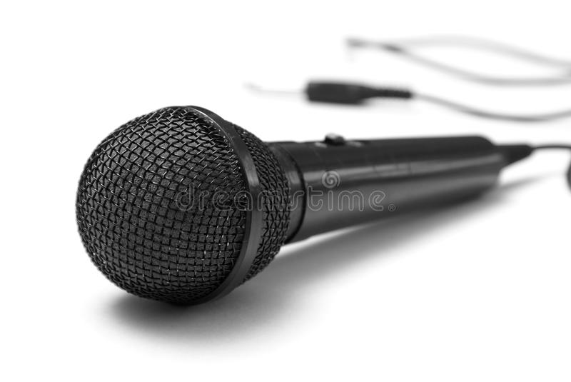 Microphone. A macro shot of a microphone over a white background stock photos