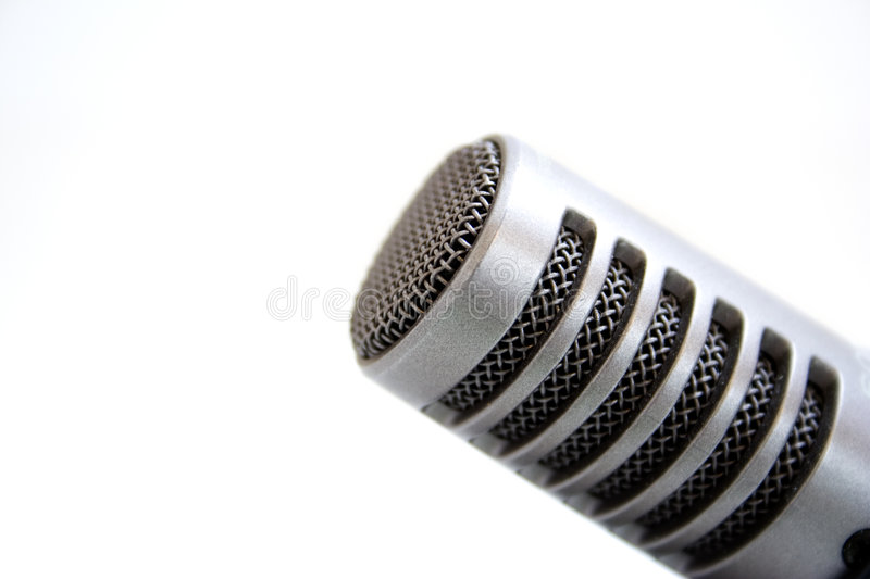 A microphone. A gray microphone on white background stock photo
