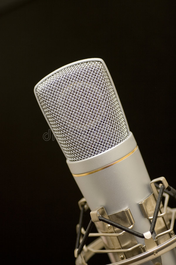 Microphone. Song microphone on dark background stock image