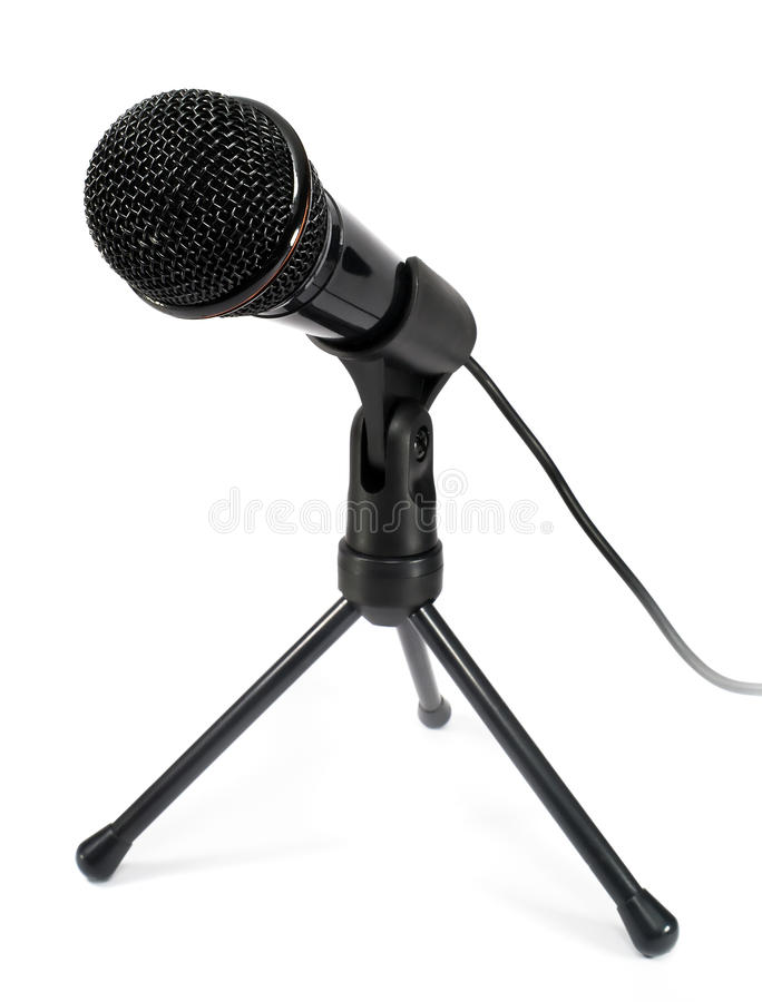 Microphone. Black new microphone on a white background stock image