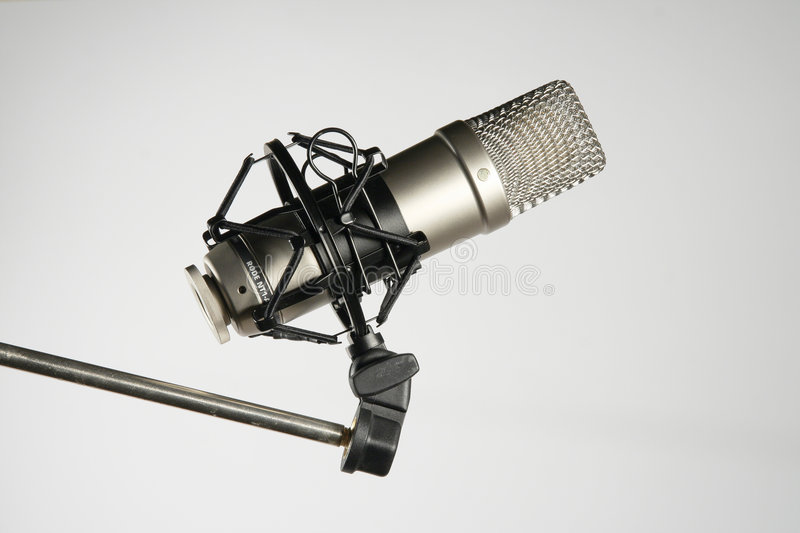 Microphone. Against gray background, sound recording royalty free stock images