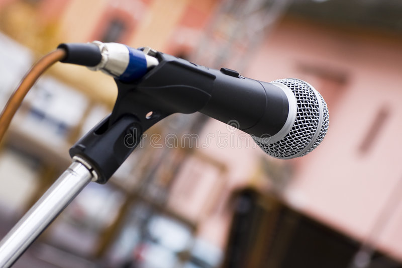 Microphone. Isolate microphone in a colored background stock photo