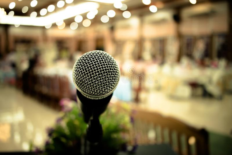 Microphone on abstract blurred of front podium and speech in seminar room or speaking conference hall light, Event meeting stock images