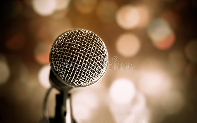 Microphone on abstract blurred of speech in seminar room or speaking conference hall light, Event concert bokeh background stock image