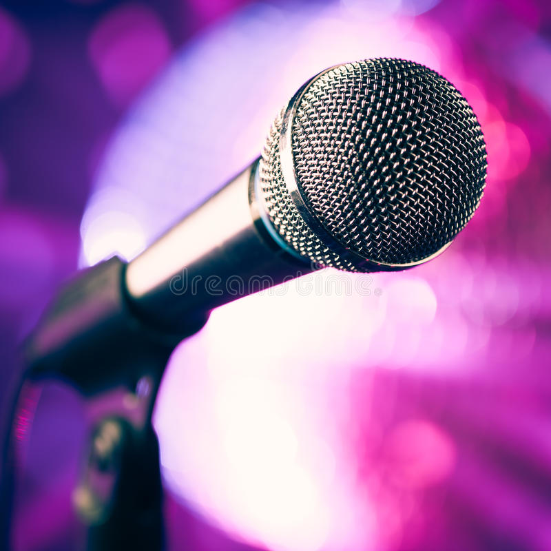 microphone against purple background stock photo image
