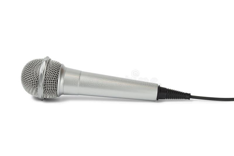 Microphone argenté sur le blanc photographie stock