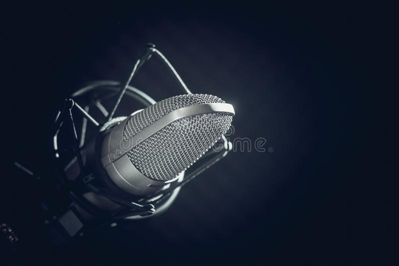 Microphone and audio console on dark background royalty free stock image