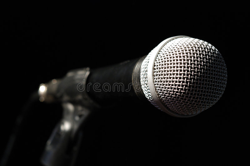 Microphone on the bar. Top down illuminated music microphone on the bar - still life stock images