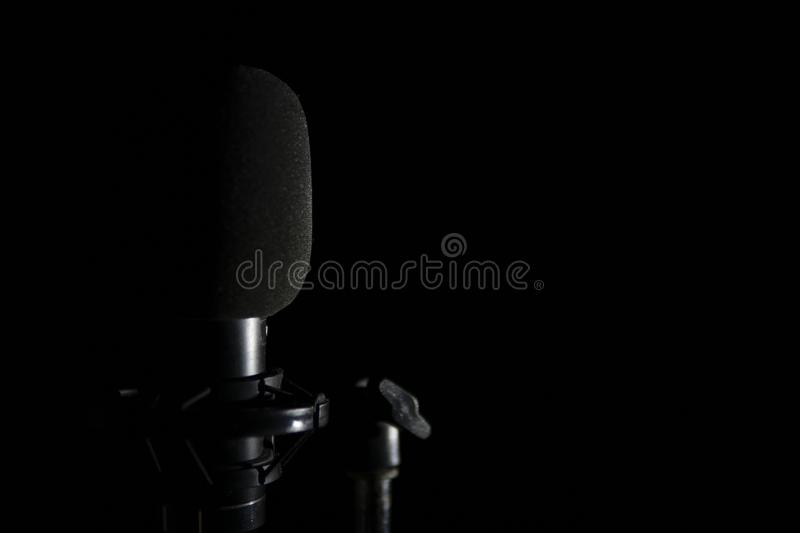 Microphone on black background stock photography