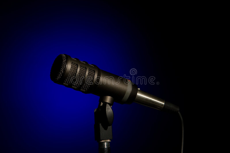 Microphone In Blue Spot royalty free stock photography